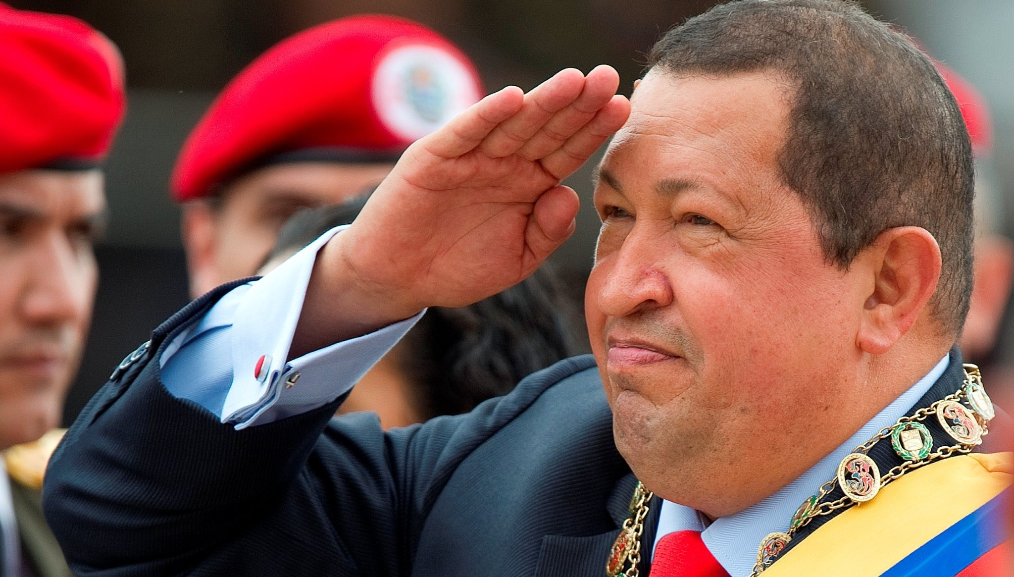 Venezuelan President Hugo Chavez salutes during a military parade to commemorate the 20th anniversary of his failed coup attempt, on February 4, 2012, in Caracas.    AFP PHOTO/JUAN BARRETO