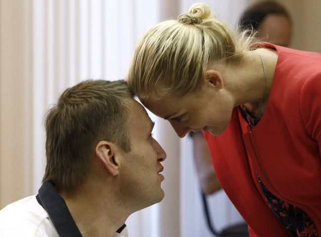 Russian opposition leader and anti-corruption blogger Alexei Navalny and his wife Yulia speak during a break in a court hearing in Kirov